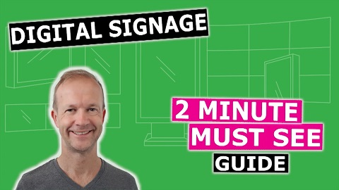 Man on green background promoting a two minute must see guide to digital signage
